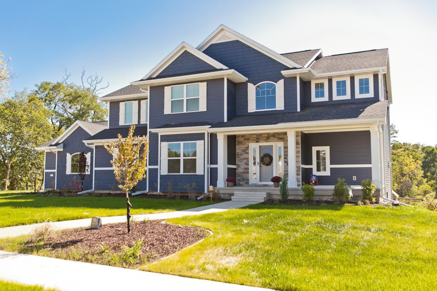 Suburban Lumber supplied the siding to this Cedar Rapids area home using Royal Vinyl in Marine Blue. To break up the long planks and add a bit of character, we added Royal Portsmouth Shingles, also in Marine Blue, along with white trim and corner accents.