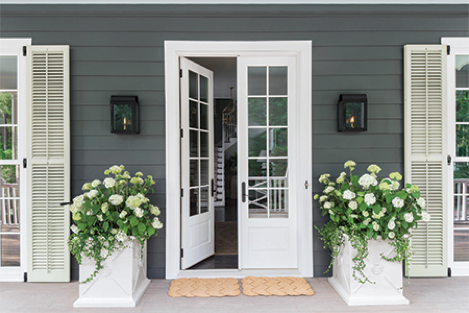 Symmetrical details like the tall potters and double mats help complete this entryway featuring French doors from Marvin.