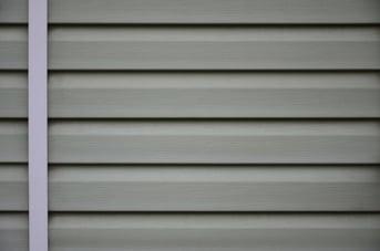 siding-plastic-panels-texture-closeup-in-the-dayti-WPMGTVZ