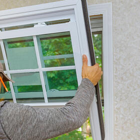 worker-in-the-installing-new-windows-in-an-house-w-UZTP4GN-1